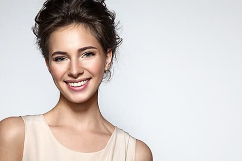 Attractive woman shows off her beautifully aligned smile