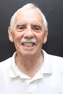 Richard full face photo after dental implants and implanted upper denture.