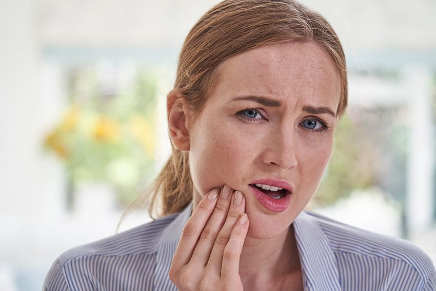 woman suffering from jaw pain